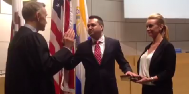 Kevin Muldoon taking the Oath of Office